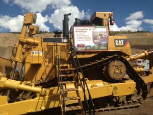 Rave Communications Signage - Smoky Canyon Cat Bulldozer